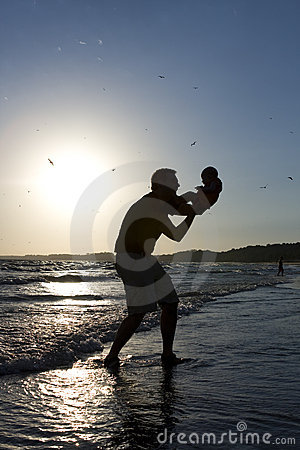Free Father And Baby Playing On Beach At Sunrise Stock Photos - 16834613