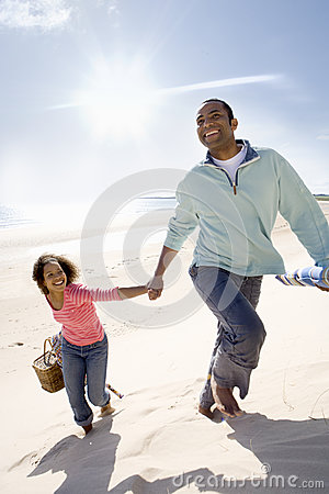 Free Father And Daughter Walking On Beach Stock Photography - 41713112