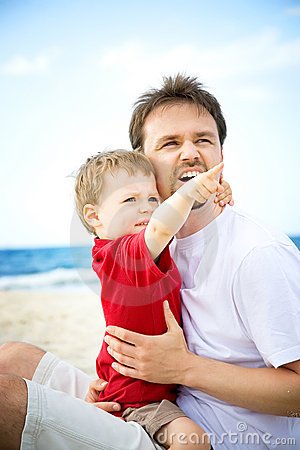 Free Father And Son Having Fun On The Beach. Royalty Free Stock Photography - 12921337