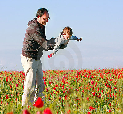 Free Father And Son In Poppy Field Stock Photo - 15344710