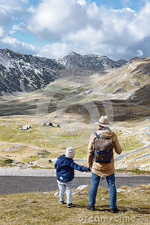 Free Father And Son Travel Together In Autumn Mountains Durmitor, Mon Royalty Free Stock Images - 81634329