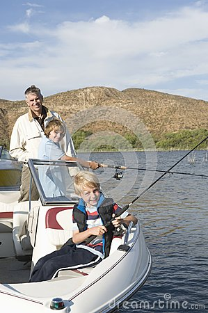 Free Father And Sons Fishing From A Boat Royalty Free Stock Photography - 29664427