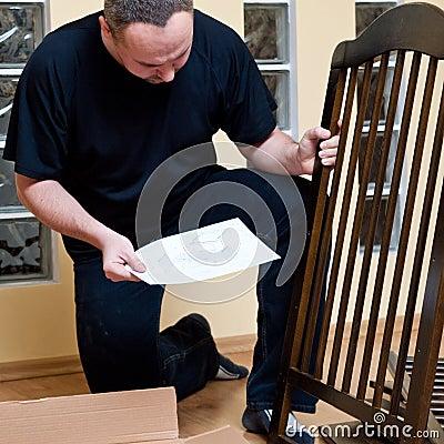 Father assembles new cot