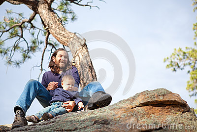 Father and baby boy in nature