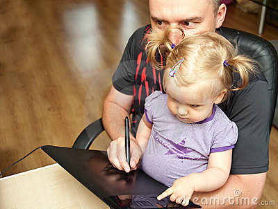 Father, baby and computer
