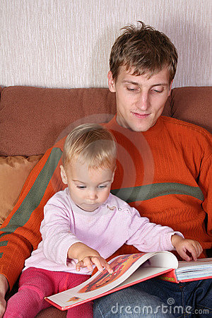 Father with baby read book