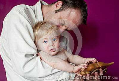 Father and baby son playing