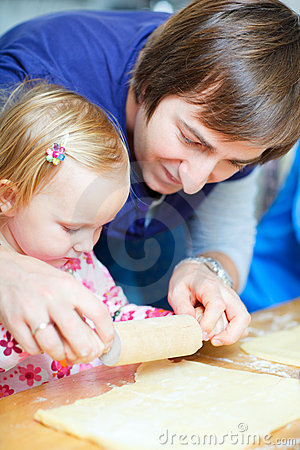Father baking together with his daughter