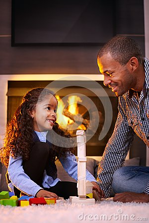 Father and beautiful daughter playing at home