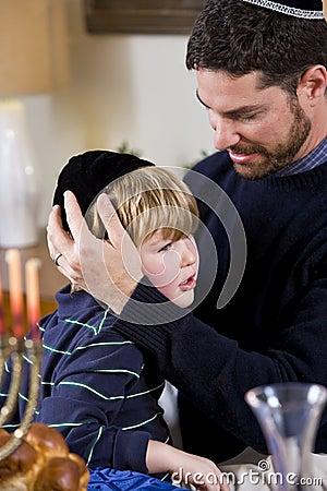Father and boy celebrating Hanukkah