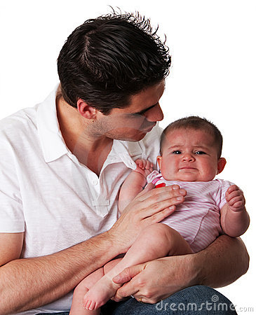 Father calming unhappy baby daughter