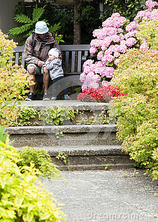 Father and child at garden
