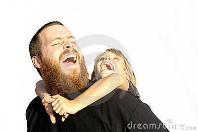 father and child playing and laughing