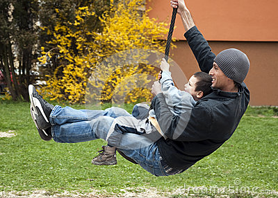 Father with child on swing