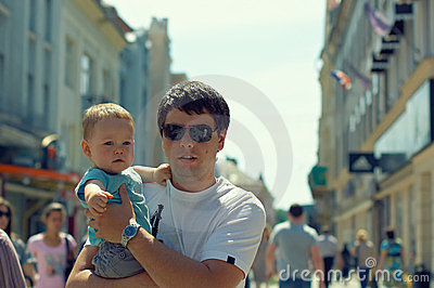 Father with child walking in the city