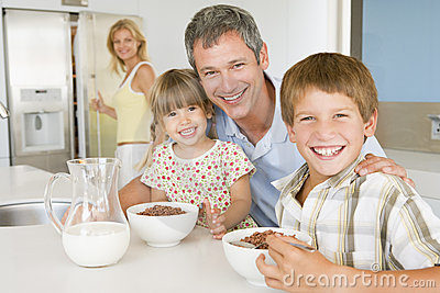 Father With Children As They Eat Breakfast
