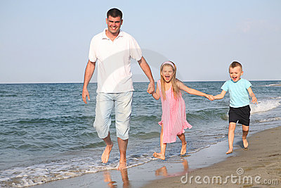 Father with children at the beach