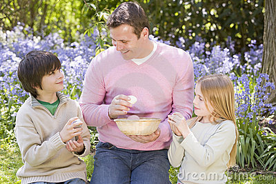Father and children on Easter look for eggs