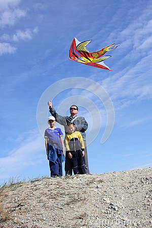 Father with children and with a kite