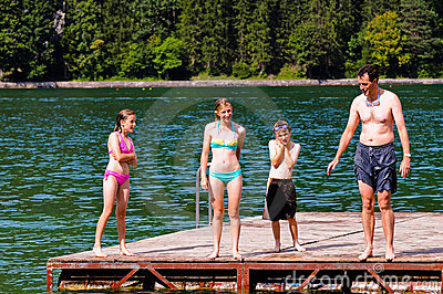 Father and children at the lake