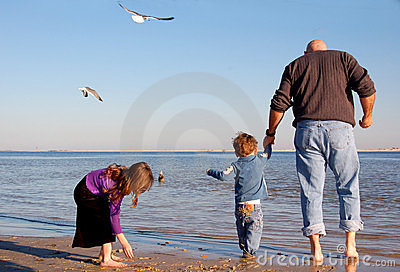 Father and Children at Shore