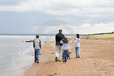 Father and children strolling