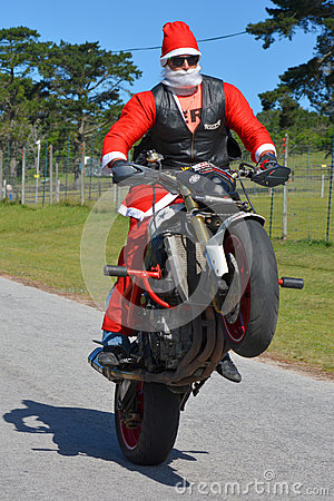 Free Father Christmas Doing A Wheelie Stock Image - 72890181