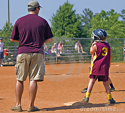 Father Coaching Daughter s Softball