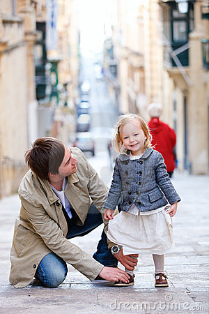 Father and daughter in city