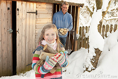Father And Daughter Collecting Logs
