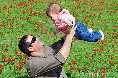 Father and Daughter in Flowering Field