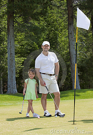 Father and Daughter Golfing
