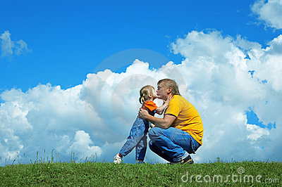 Father with daughter on green grass
