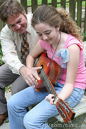 Free Father Daughter Guitar Lesson 1 Stock Photo - 140180