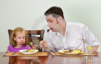 Father and daughter having dinner