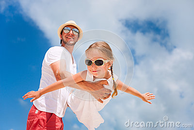 Father and daughter having fun