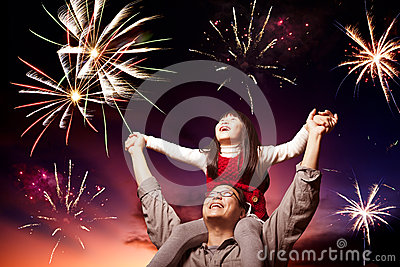 Father and daughter looking fireworks
