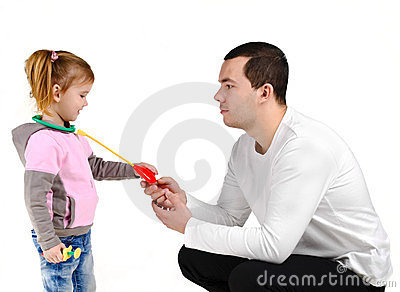 Father and daughter playing with stethoscope