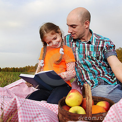 Father and daughter read book