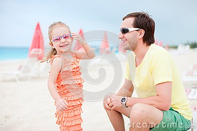 Father and daughter at resort beach