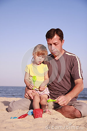 Father and daughter on the sea shore