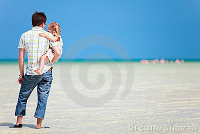 Father and daughter at shallow water