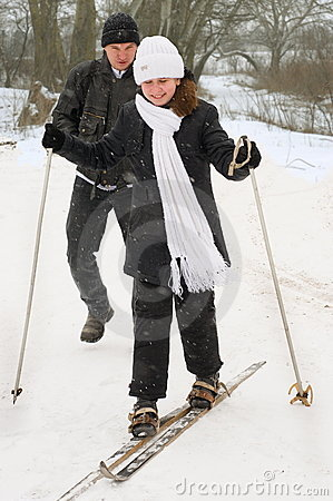 The father, the daughter and skis.