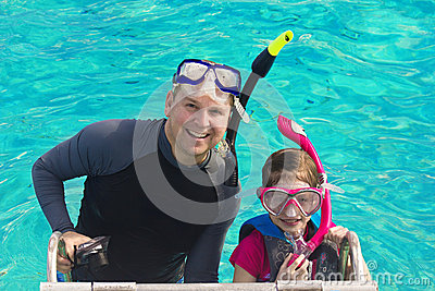 Father and Daughter Snorkeling in the Caribbean
