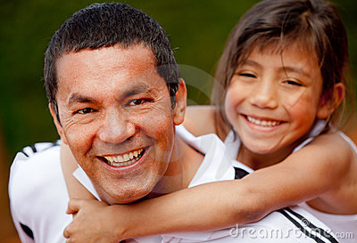 Father and daughter at the tennis court