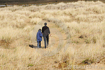 Father and daughter on walk in countryside