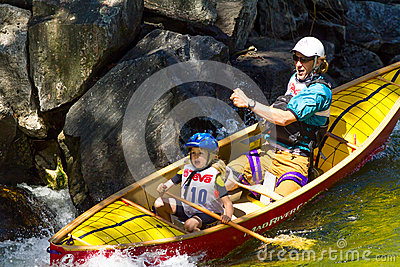 Father and daughter in a whitewater canoe Editorial Stock Photo