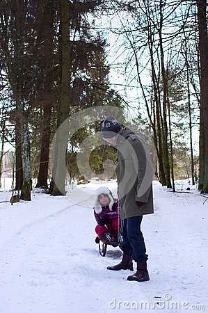Father with daughter in winter fun