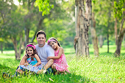 Father and daughters on picnic