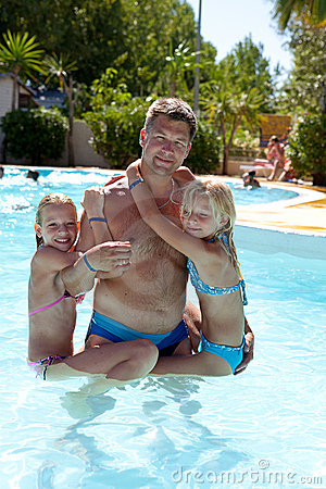 Father and daughters in the swim pool